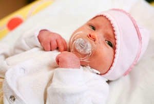 Adorable baby with pacifier